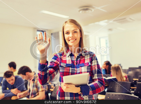group of smiling students with tablet pc stock photo, education, high school, gesture and people concept - group of smiling students with tablet pc computer waving hand in lecture hall by Syda Productions