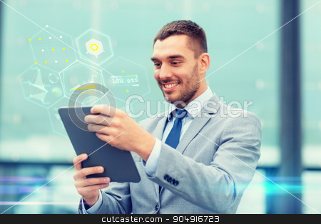 smiling businessman with tablet pc outdoors stock photo, business, education, technology and people concept - smiling businessman working with tablet pc computer and virtual chart projection on city street by Syda Productions