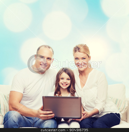 smiling family with laptop stock photo, family, childhood, holidays, technology and people concept - smiling family with laptop computer over blue lights background by Syda Productions