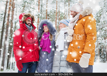 group of smiling men and women in winter forest stock photo, love, relationship, season, friendship and people concept - group of smiling men and women talking in winter forest by Syda Productions