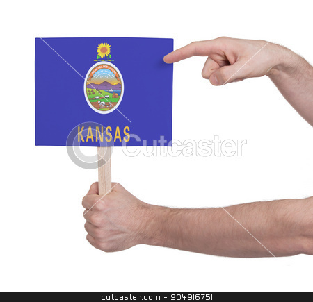 Hand holding small card - Flag of Kansas stock photo, Hand holding small card, isolated on white - Flag of Kansas by michaklootwijk