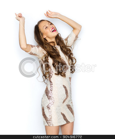 happy young woman or teen girl in fancy dress stock photo, people, style, holidays and fashion concept - happy young woman or teen girl in fancy dress with sequins and long wavy hair dancing at party by Syda Productions