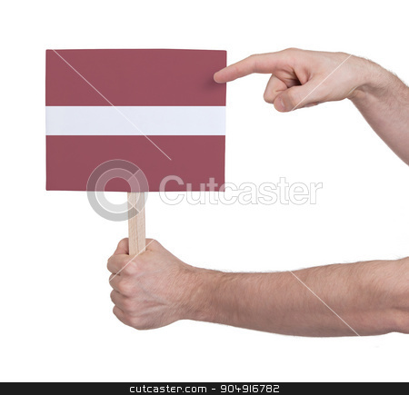 Hand holding small card - Flag of Latvia stock photo, Hand holding small card, isolated on white - Flag of Latvia by michaklootwijk