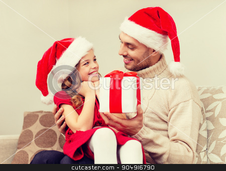 smiling father giving daughter gift box stock photo, family, christmas, x-mas, happiness and people concept - smiling father giving daughter gift box by Syda Productions