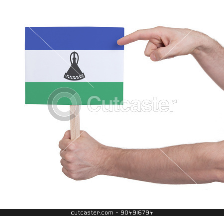 Hand holding small card - Flag of Lesotho stock photo, Hand holding small card, isolated on white - Flag of Lesotho by michaklootwijk