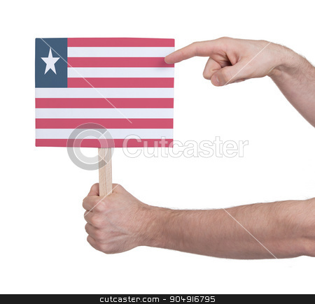 Hand holding small card - Flag of Liberia stock photo, Hand holding small card, isolated on white - Flag of Liberia by michaklootwijk