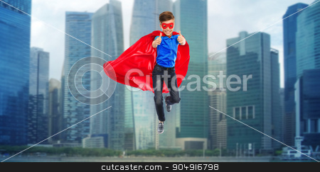 boy in super hero cape and mask showing thumbs up stock photo, happiness, freedom, childhood, movement and people concept - boy in red super hero cape and mask flying in air and showing thumbs up by Syda Productions