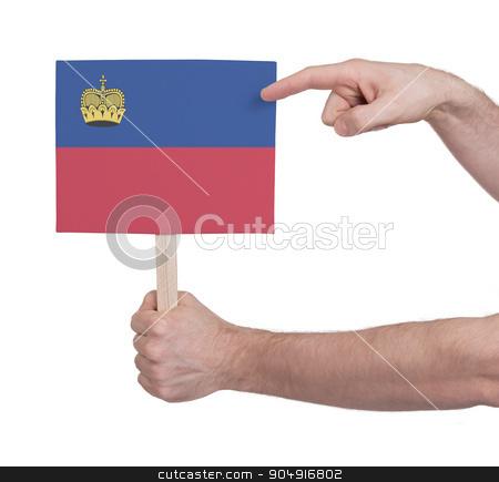 Hand holding small card - Flag of Liechtenstein stock photo, Hand holding small card, isolated on white - Flag of Liechtenstein by michaklootwijk