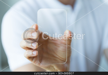 close up of male hand with transparent smartphone stock photo, business, technology and people concept - close up of male hand holding and showing transparent smartphone at office by Syda Productions