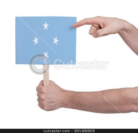 Hand holding small card - Flag of Micronesia stock photo, Hand holding small card, isolated on white - Flag of Micronesia by michaklootwijk