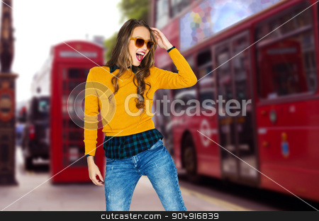 happy young woman or teen over london city street stock photo, people, travel, tourism, style and fashion concept - happy young woman or teen girl in casual clothes and sunglasses having fun over london city street background by Syda Productions