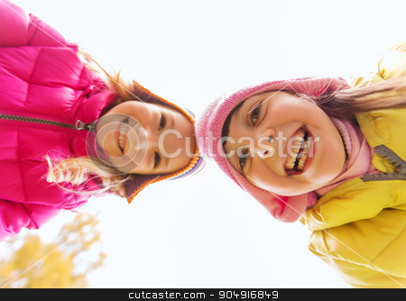 happy girls faces outdoors stock photo, childhood, leisure, friendship and people concept - happy girls faces outdoors by Syda Productions