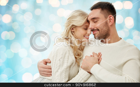 happy couple over blue holidays lights background stock photo, family, love, winter, holidays and people concept - happy couple over blue holidays lights background by Syda Productions