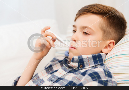 ill boy with flu and thermometer at home stock photo, childhood, healthcare and medicine concept - ill boy with flu measuring temperature by thermometer at home by Syda Productions