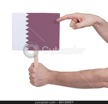 Hand holding small card - Flag of Qatar stock photo, Hand holding small card, isolated on white - Flag of Qatar by michaklootwijk