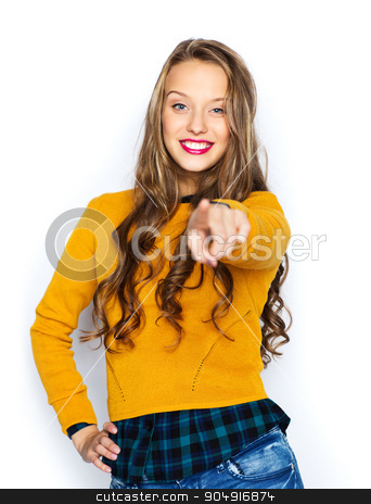 happy young woman or teen pointing finger on you stock photo, people, style and fashion concept - happy young woman or teen girl in casual clothes pointing finger on you by Syda Productions