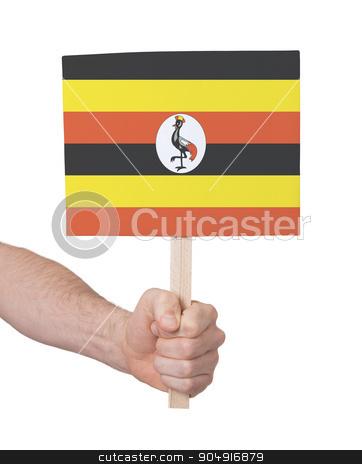 Hand holding small card - Flag of Uganda stock photo, Hand holding small card, isolated on white - Flag of Uganda by michaklootwijk