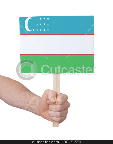 Hand holding small card - Flag of Uzbekistan stock photo, Hand holding small card, isolated on white - Flag of Uzbekistan by michaklootwijk