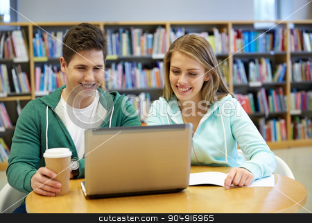 happy students with laptop in library stock photo, people, education, technology and school concept - happy students with laptop computer networking in library by Syda Productions