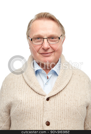 smiling senior man in cardigan stock photo, age, fashion and people concept - smiling senior man in cardigan by Syda Productions