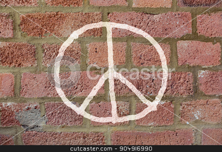 peace sign drawing on red brick wall stock photo, symbolic, pacifism and hippie concept - peace sign drawing on red brick wall by Syda Productions