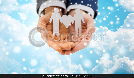 close up of happy male gay couple with love symbol stock photo, people, homosexuality, same-sex marriage and love concept - close up of happy male gay couple holding paper cutout love symbol over blue sky and clouds background over snow effect by Syda Productions