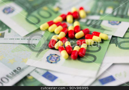 medical pills or drugs and euro cash money stock photo, medicine, finance, health care and drug trafficking - medical pills or drugs and euro cash money on table by Syda Productions