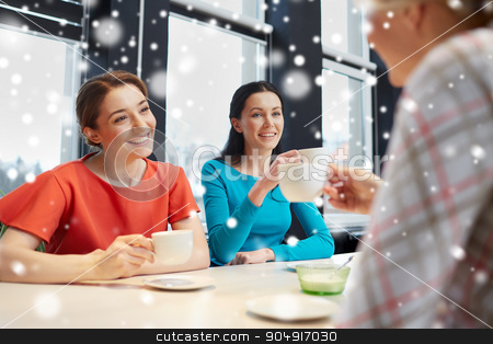 happy young women drinking tea or coffee at cafe stock photo, people, leisure, friendship and communication concept - happy young women meeting and drinking tea or coffee at cafe over snow effect by Syda Productions