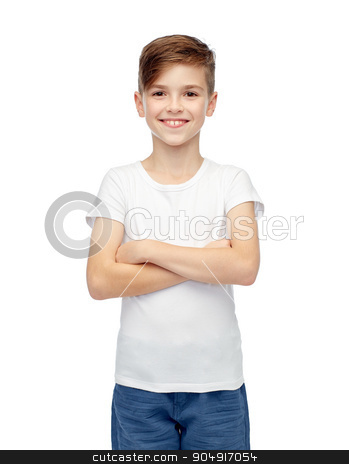 happy boy in white t-shirt and jeans stock photo, childhood, fashion, advertisement and people concept - happy boy in white t-shirt and jeans by Syda Productions