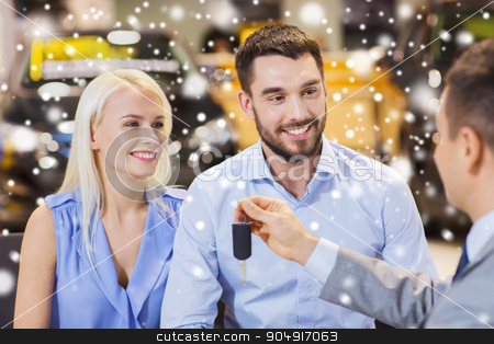 happy couple with car dealer in auto show or salon stock photo, auto business, sale and people concept - happy couple with dealer giving car key in auto show or salon over snow effect by Syda Productions