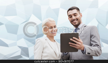 smiling businessmen with tablet pc outdoors stock photo, business, partnership, technology and people concept - smiling businessman and businesswoman with tablet pc computer over gray blue graphic low poly background by Syda Productions