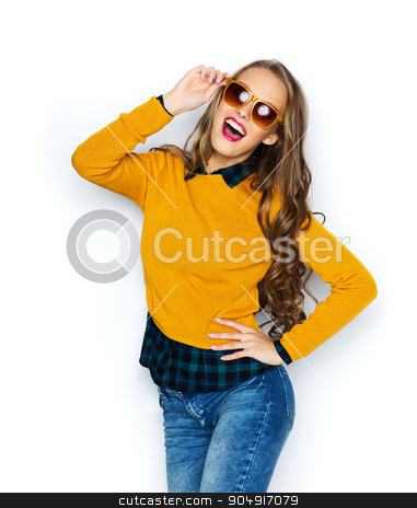 happy young woman or teen girl in casual clothes stock photo, people, style and fashion concept - happy young woman or teen girl in casual clothes and sunglasses having fun by Syda Productions