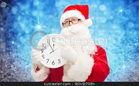 man in costume of santa claus with clock stock photo, christmas, holidays, time and people concept - man in costume of santa claus with clock showing twelve pointing finger over blue glitter or lights background by Syda Productions