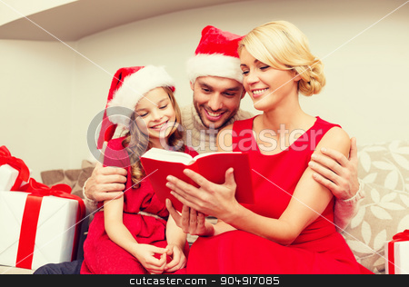 smiling family reading book stock photo, family, christmas, x-mas, winter, happiness and people concept - smiling family in santa helper hats with many gift boxes reading book by Syda Productions