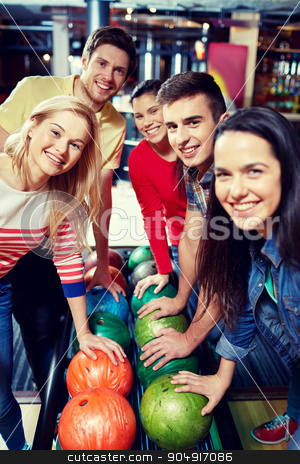 happy friends in bowling club stock photo, people, leisure, sport, friendship and entertainment concept - happy friends in bowling club by Syda Productions