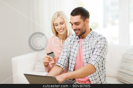 happy couple with laptop and credit card at home stock photo, technology, people, e-money and commerce concept - smiling happy couple with laptop computer and credit or bank card shopping online at home by Syda Productions