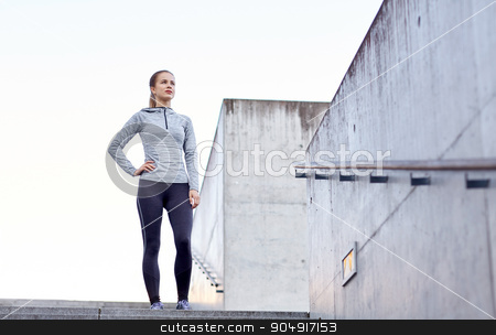 sportive woman at city stock photo, fitness, sport, people and lifestyle concept - sportive woman at city by Syda Productions