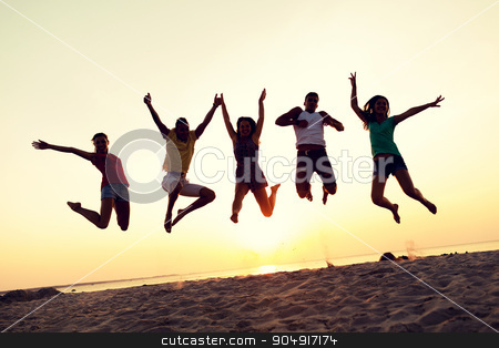 smiling friends dancing and jumping on beach stock photo, friendship, summer vacation, holidays, party and people concept - group of smiling friends dancing and jumping on beach by Syda Productions