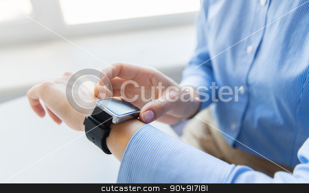 close up of hands setting smart watch stock photo, business, technology and people concept - close up of woman hands setting smart watch at office by Syda Productions