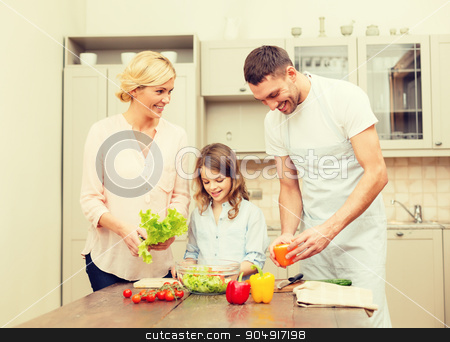 happy family making dinner in kitchen stock photo, food, family, hapiness and people concept - happy family making dinner in kitchen by Syda Productions