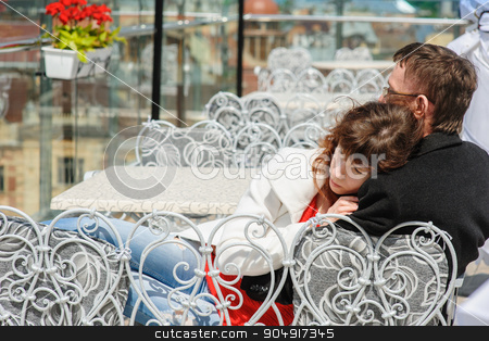 couple at a table in a cafe. The woman on the man's shoulder stock photo, couple at a table in a cafe. The woman on the man's shoulder. by timonko