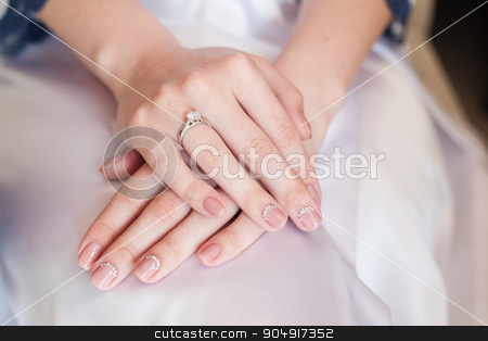 Bride hand with manicure on wedding dress stock photo, Bride hand with manicure on wedding dress. by timonko
