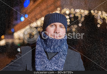 Portrait of elegant fashionable man dressed in coat and scarf stock photo, Portrait of elegant fashionable man dressed in coat and scarf. by timonko