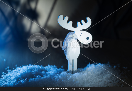 White wooden toy moose in the snow stock photo, White wooden toy moose in the snow. by timonko