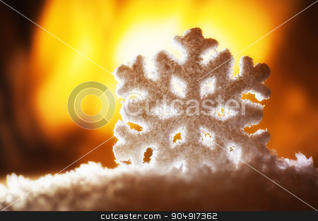 big snowflake toy in snowdrift on hill stock photo, big snowflake toy in snowdrift on hill. by timonko