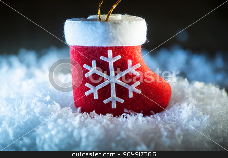 Red Santa's boot with snowflake in snow stock photo, Red Santa's boot with snowflake in snow. by timonko
