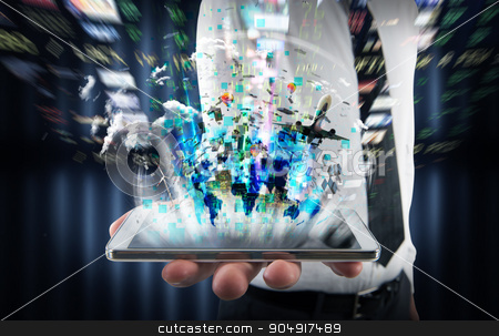 Multimedia on cell phone stock photo, Businessman holding a cell with bright screen by Federico Caputo