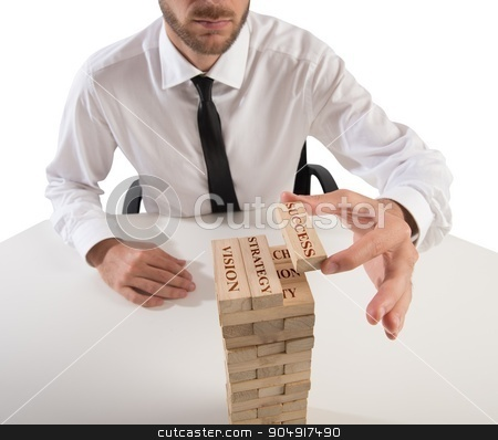 Building business game stock photo, Businessman make a building with wood blocks by Federico Caputo