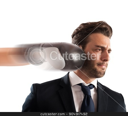 Punched businessman stock photo, Businessman hit by a punch of boxer by Federico Caputo