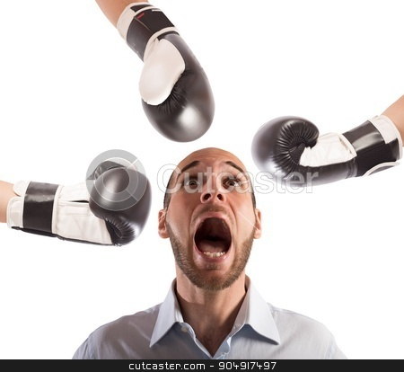 Hit an afraid businessman stock photo, Many boxing punches hit an afraid businessman by Federico Caputo